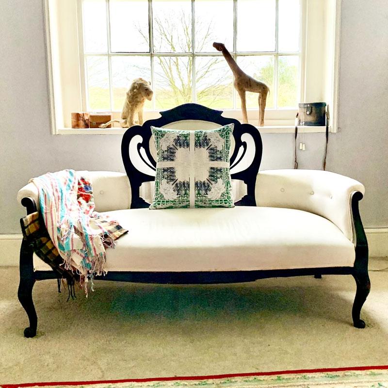 Femi - Cushion on White Sofa